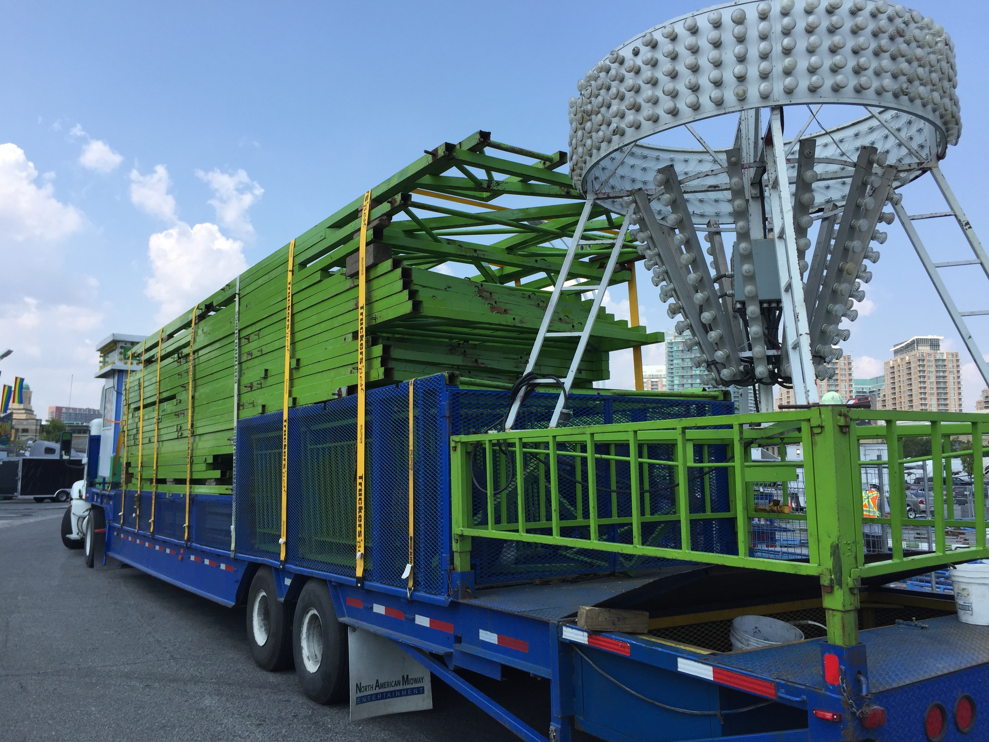 Roller coaster parts on trailer waiting to be constructed
