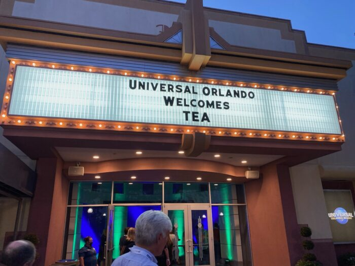 """Marquee of Soundstage 33 backstage at Universal Orlando, reads """"Universal Orlando Welcomes T.E.A."""" Lighted sign Universal Orlando Resort off to one side. Other participants are seen entering the building (no faces visible)."""
